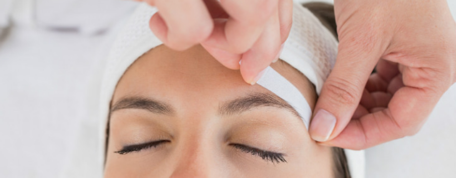Waxing eyebrow shaping